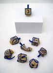 Warped.  2012.  3D printed plaster, enamel. each dreidel is about 2 x 3 x 1.5 in.