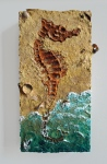 Coney Island Sea Horse.  2014.  Acrylic, sand, and garbage on panel.  17x8x2.5 in.